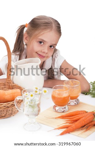 Girl drinking juice and holding a bunch of carrots on a white background - stock photo