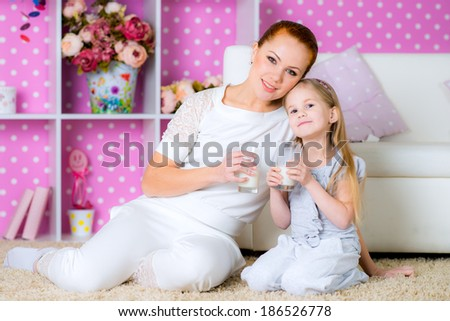 girl drinking milk at home - stock photo