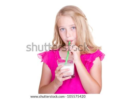 Girl drinking milk through a straw, isolated on white - stock photo