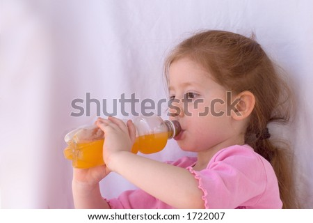 Girl drinking orange beverage - stock photo