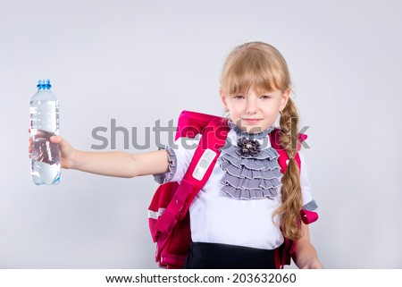 girl drinking water from a plastic bottle - stock photo