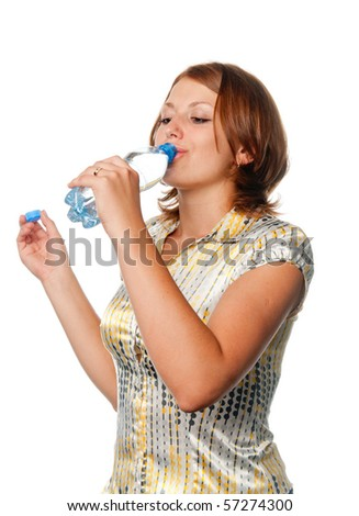 Girl drinks water from a bottle