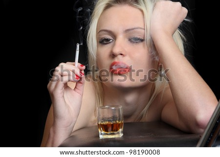 girl drinks whisky, smokes  cigarette.  black background - stock photo