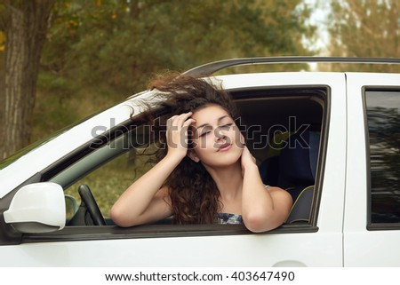 girl driver inside car portrait, eyes closed and dreaming , summer season