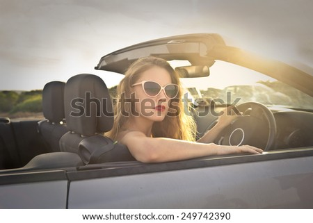 Girl driving a car  - stock photo