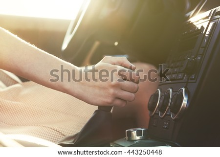 girl driving car moving transmission shift gear