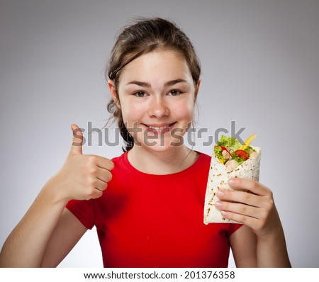 Girl eating big sandwich - stock photo