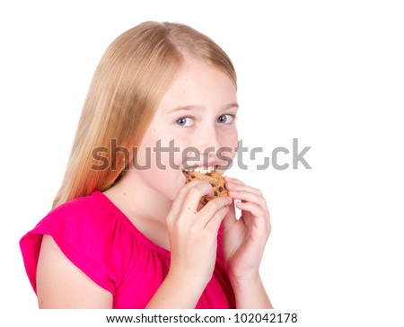 Girl eating chocolate chip cookie isolated on white background
