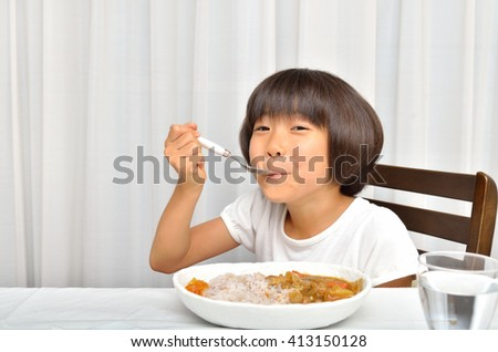Girl eating delicious Curry