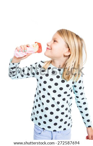 Girl eating delicious strawberry ice cream in a cone and smiling - stock photo
