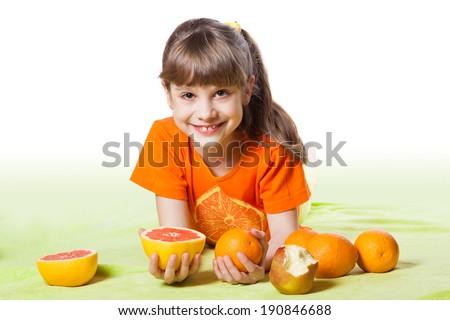 girl eating fruit - stock photo