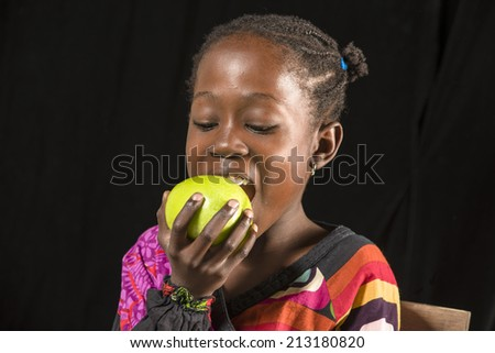 Girl eating fruit - stock photo