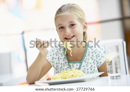 Girl Eating Lunch At A Cafe - stock photo