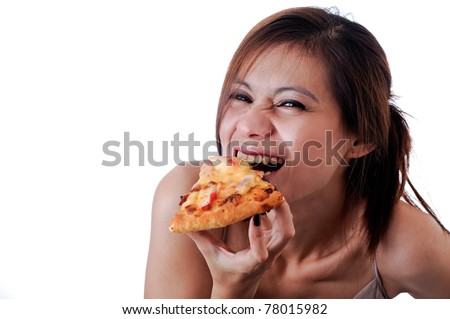 Girl eating pizza isolated on white