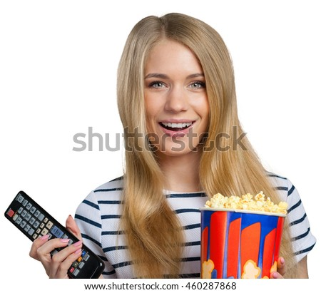 girl eating popcorn and watching tv