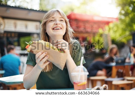 girl eating taco hungry freckled blonde stock photo edit now
