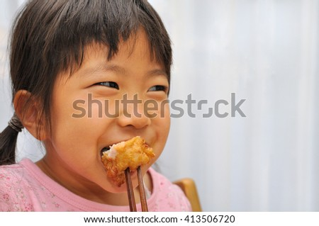 Girl eating the delicious fried chicken