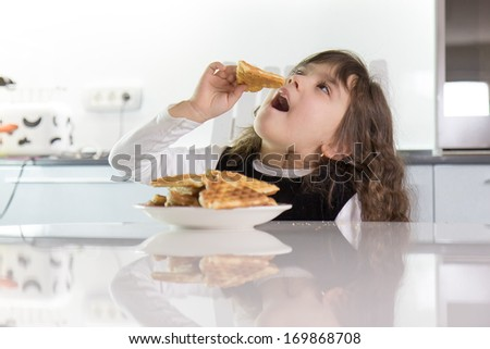 Girl eating waffles - stock photo