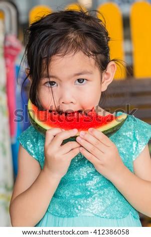 girl eating watermelon - stock photo