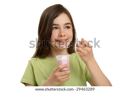 Girl eating yogurt isolated on white background - stock photo