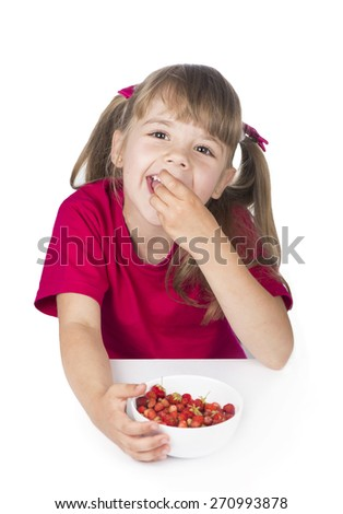 girl eats  strawberry, holding a strawberry, isolated on white   - stock photo