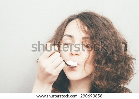 girl eats with a fork - stock photo