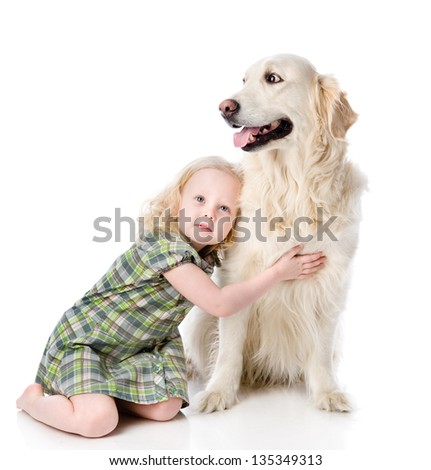 girl embraces a Golden Retriever. looking away. isolated on white background