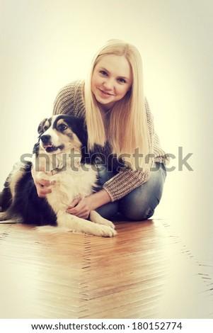 girl embraces dog - stock photo