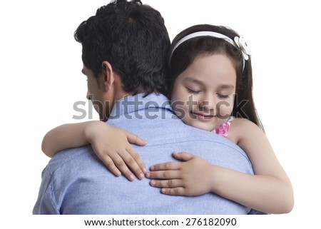 Girl embracing father over white background - stock photo