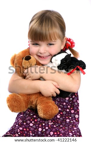 girl embracing favorite toys