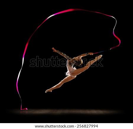 Girl engaged art gymnastics isolated - stock photo