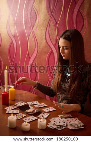 girl engaged in witchcraft - stock photo