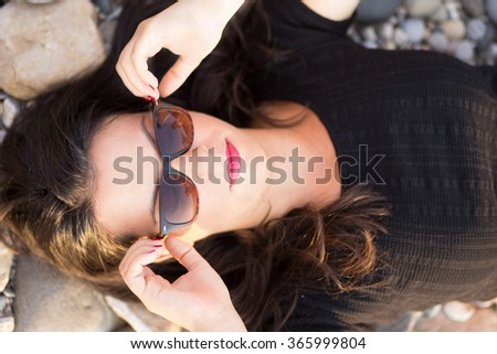 Girl enjoy in summer sun by the river - stock photo