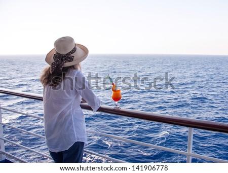 girl enjoying a cocktail while cruising - stock photo