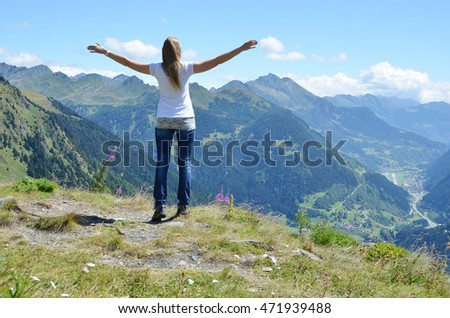 Girl enjoying Alpine scenery at Gotthard pass, Switzerland