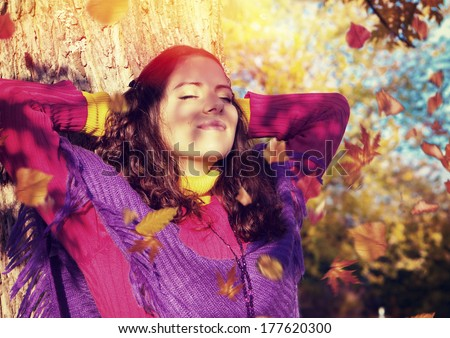 girl enjoying leisure in a park on a autumn-day - stock photo
