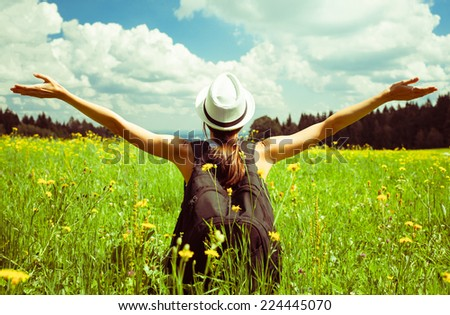 Girl enjoying the freedom outdoors - stock photo