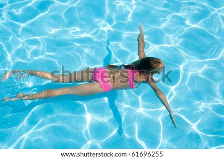 girl enjoys an underwater swim