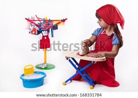 Girl erases and iron clothes - stock photo