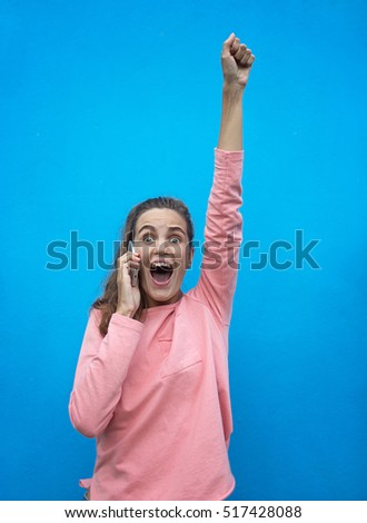 Girl excited. shot on a  blue background