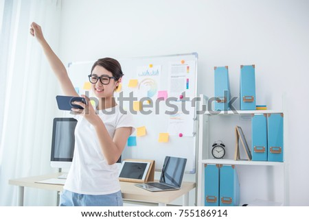 girl exciting in office near her seat using smart phone