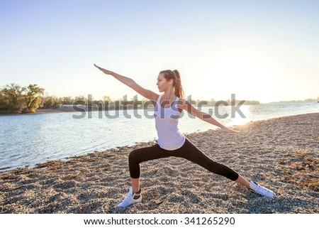 girl exercise by the lake  autumn day, full body shot - stock photo