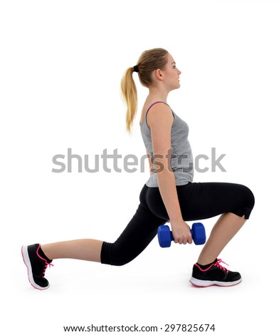 Girl exercise thighs muscles with dumbbells on white background - stock photo