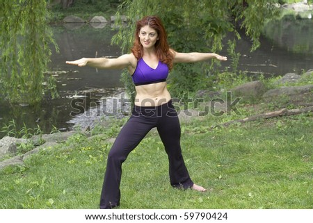 Girl exercising in park.