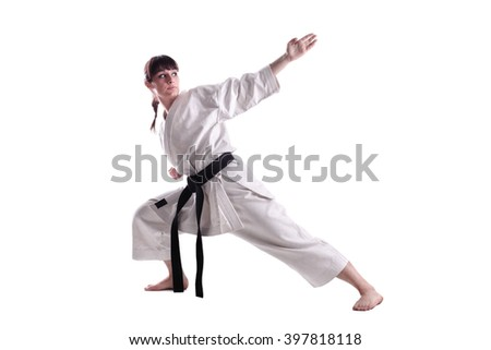 girl exercising karate, against white background - stock photo