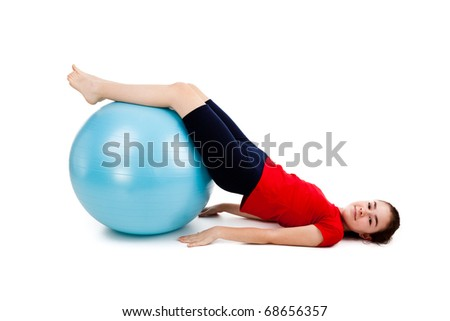 Girl exercising using ball on white background