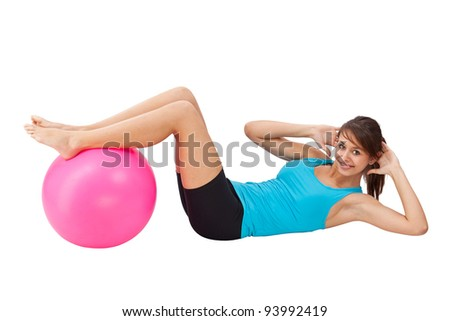 Girl exercising with fitness ball, isolated in white