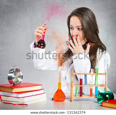 Girl experimenting with chemical liquids - stock photo