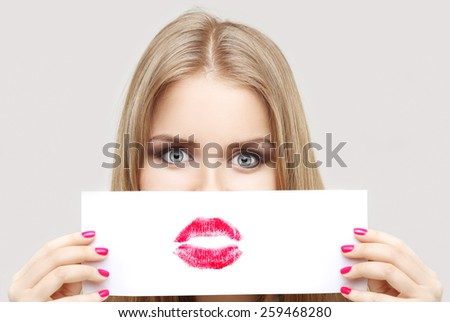 Girl fitting red lips - stock photo