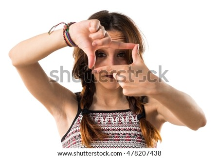 Girl focusing with her fingers